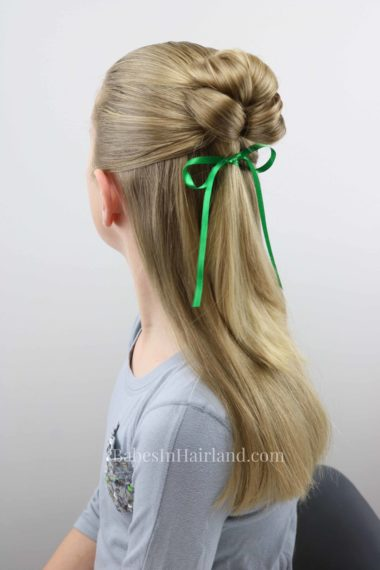 This is the cutest 4 leaf clover hairstyle for St. Patrick's Day I've seen in a long time!  BabesInHairland.com has a fast and easy tutorial for this lucky hairstyle! #hair #hairstyle #shamrock #stpatricksday #lucky #4leafclover #4leafcloverhairstyle