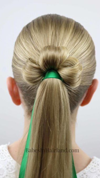 This is the cutest St. Patrick's Day hairstyle I've seen! Try a Shamrock Ponytail for luck from BabesInHairland.com has a fast and easy tutorial for this lucky hairstyle! #hair #hairstyle #shamrock #stpatricksday #lucky #3leafclover #3leafcloverhairstyle