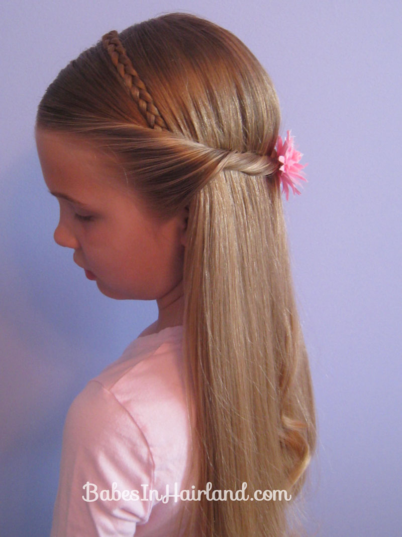 Faux hair braid attached to a black plastic headband. -The braid is about 3/4