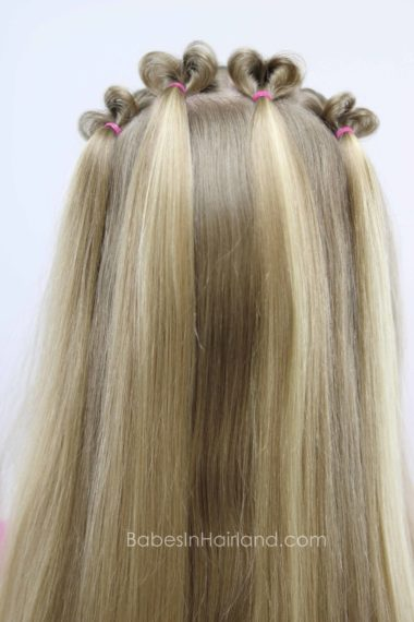 Looking for a Valentine's Day hairstyle? Look no further than this cute Topsy Tail Heart hairstyle from BabesInHairland.com | hair | holiday hair | easy hairstyle