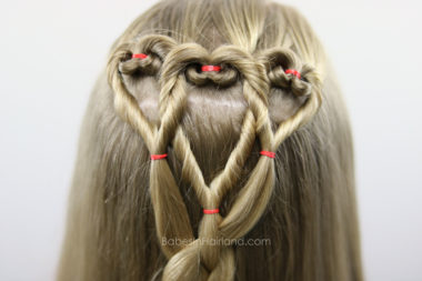 Three hearts are better than one! We love this twisted heart and 4 strand braid hairstyle from BabesInHairland.com. It's perfect for school Valentine's Day parties. hair   braids   love